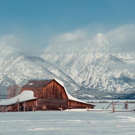 Snowy Wyoming farm with the Grand Tetons in the background