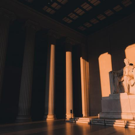 The sun shining on the Lincoln Memorial in Washington, D.C.
