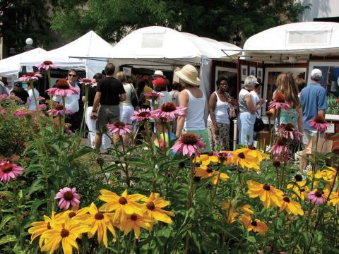 Browsing the stalls of artwork at Denver's Cherry Creek Arts Festival