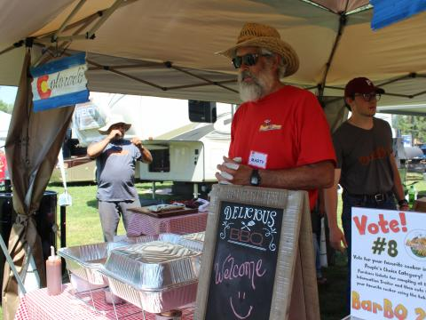 A barbecue vendor competing in the Beat the Heat BBQ, Brews & Chili competition in Alamosa, Colorado
