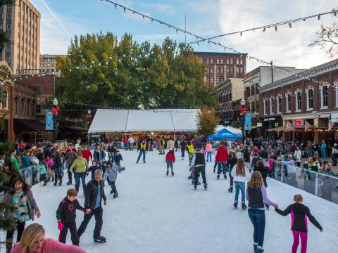 Ice skating in Market Square in downtown Knoxville, Tennessee as part of the city's Christmas celebrations