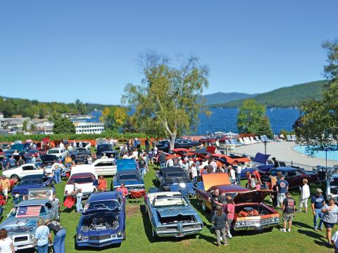 Vintage cars on display during the Adirondack Nationals Car Show overlooking Lake George, New York