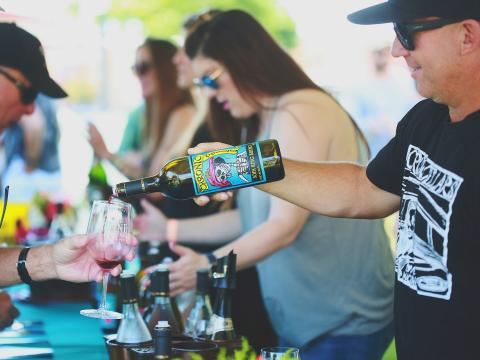 Pouring wine samples during Wine Festival Weekend in Paso Robles, California