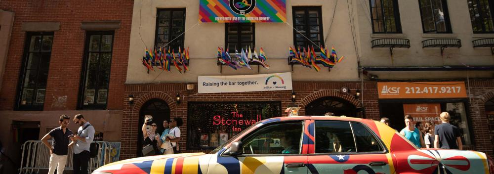 The United Stories Studio car in front of the historic Stonewall Inn, where 1969 riots launched the gay rights movement